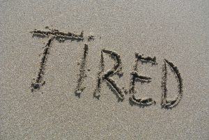 """tired"", written on the beach"