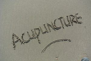 acupuncture, βελονισμος γραμμένο στην άμμο