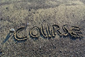 """course"", written in beach"